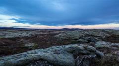 Moon rising over mossy lava field, slider shot Thingvellir Iceland Stock Footage
