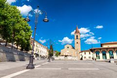 AREZZO, ITALY - MAY 12, 2015: People walk in Saint Augustin Square. Arezzo is - stock photo