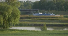 Ship, Boat Standing in The Channel, Canal Close to Meadow and Bridge - stock footage