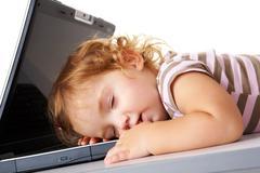 Sleeping with laptop Stock Photos