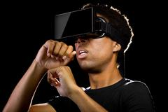 Virtual Reality Headset On Gamer - stock photo