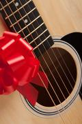 Guitar Strings with Red Ribbon - The Gift of Music. - stock photo