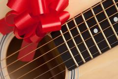 Guitar Strings with Red Ribbon - The Gift of Music. Stock Photos