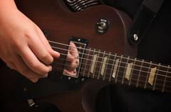 Musician Plays His Gibson - stock photo