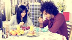 Cute couple feeling happy having breakfast at home retro style Stock Footage