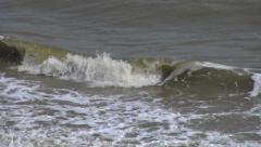 Close Up of Rolling Sea Waves and Murky Water on a Stormy Day - stock footage