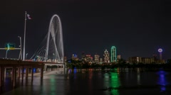 Dallas skyline at night reflecting in River w/Margaret Hunt Hill Bridge TL Stock Footage