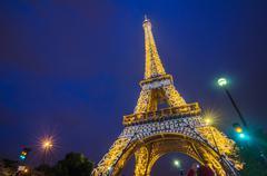 Eiffel Tower brightly illuminated at twilight, Paris Stock Photos