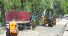 City Day Opole Men Take Shovel Geodesic Tripod From Lorry Excavator at Road Stock Footage