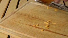 Grating cheddar cheese - stock footage