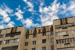 Cloudy Blue Sky Skyscape and Apartments Stock Photos