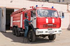 Russian Firemen Working on a Kamaz Fire Vehicle Kuvituskuvat