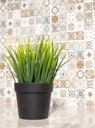 Artifical Grass and Ceramic Tiles - stock photo