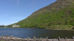 Kylemore Abbey view from across the lake + Connemara mountains in spring Stock Footage