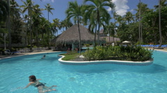Woman swimming in the pool at Vista Sol Hotel, The Dominican Republic Stock Footage