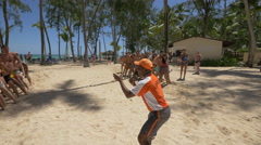 Tourists winning a competition in the Dominican Republic Stock Footage