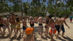 Stock Video Footage of Playing over and under relay on the beach in The Dominican Republic