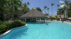 People swimming in the pool at Vista Sol Hotel, Dominican Republic Stock Footage