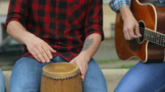 Cheerful perky musicians playing guitars and drums, vocalist sings a song  Stock Footage