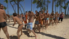 Playing a ball relay game on the beach, Dominican Republic Stock Footage