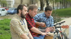 Three talented guys perform on the street with passion Stock Footage