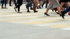 People cross the road at a pedestrian crossing. City life Stock Footage