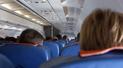 Interior of airplane with passengers on seats - stock footage