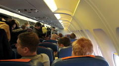 Interior of airplane with passengers on seats, - stock footage