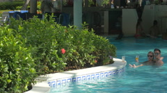 Swimming in the great pool of Vista Sol Hotel in The Dominican Republic Stock Footage