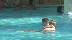 Couple swimming in the pool in Punta Cana, The Dominican Republic Stock Footage