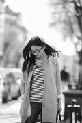 Beautiful model walks in europian city. Stock Photos