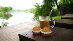 Hot coffee and two banana cupcake Stock Footage