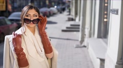 Beautiful Brunette Girl in Gloves and Sunglasses - stock footage