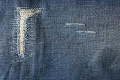 Stock Photo of denim jeans blue old torn with fashion design