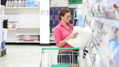 Woman buys a pillow in the store Stock Footage