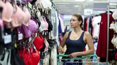 Stock Video Footage of Woman buying a bra