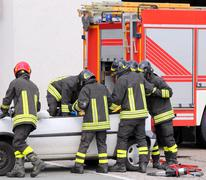 italian firefighters relieve an injured - stock photo