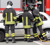 firefighters relieve an injured after a road accident - stock photo