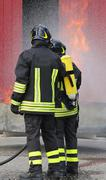 Firefighters with oxygen bottles off the fire during a training exercise Kuvituskuvat