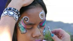 Asian Girl Gets Magic Gold Fairy Dust Painted On Her Face - stock footage