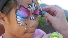 Asian Girl Gets Magic Fairy Dust Painted On Her Face - stock footage