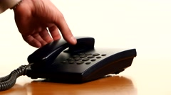 Businessman making a phone call on landline telephone. Conceptual of customer - stock footage