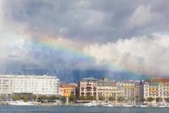 View of Geneva from the lake Lehman through a rainbow in the fountain, Switze Kuvituskuvat