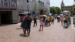 People in entertainment park Disneyland Resort in Hong Kong Stock Footage