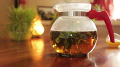 Teapot with healthy tea Stock Footage