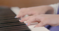 Girls hands playing piano two chords close up Stock Footage