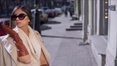 Beautiful Girl in Sunglasses and Gloves Stock Footage