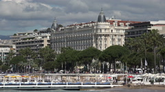 Cannes Carlton Hotel over beach de la Croisette, France Stock Footage