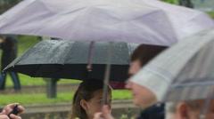 People with Umbrellas Walk Under the Rain 10 - stock footage