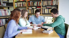 Students with books preparing to exam in library Stock Footage